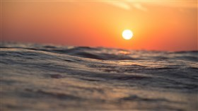 Sunset on the Ocean Waves